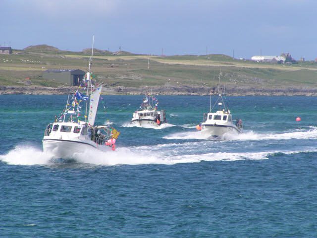 Fishing boats racing at Fionnphort Gala